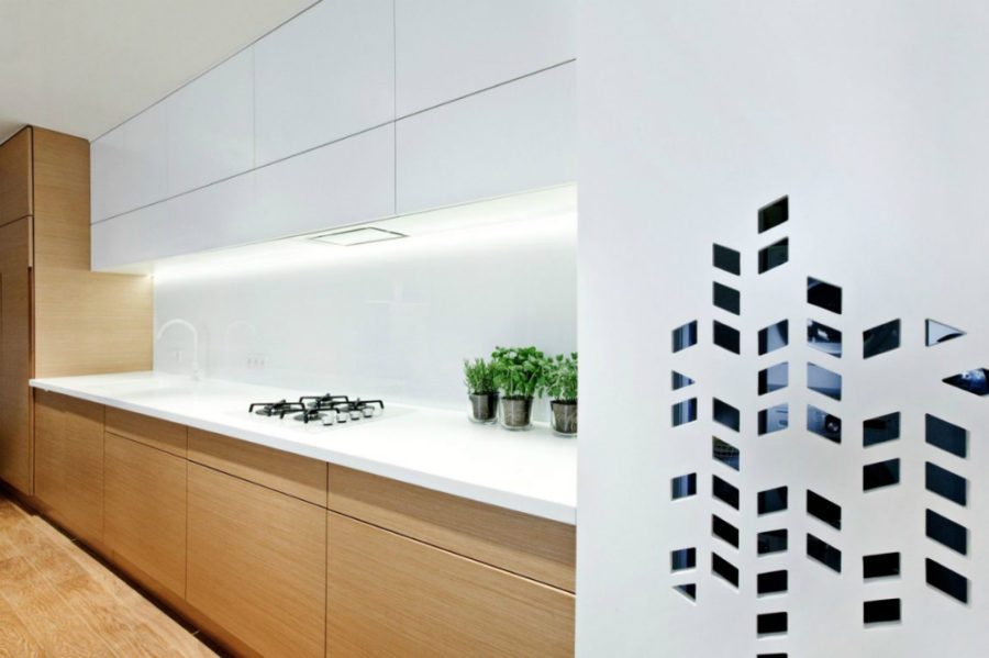 White coutertop backsplash and hardware play into the home's minimalist style