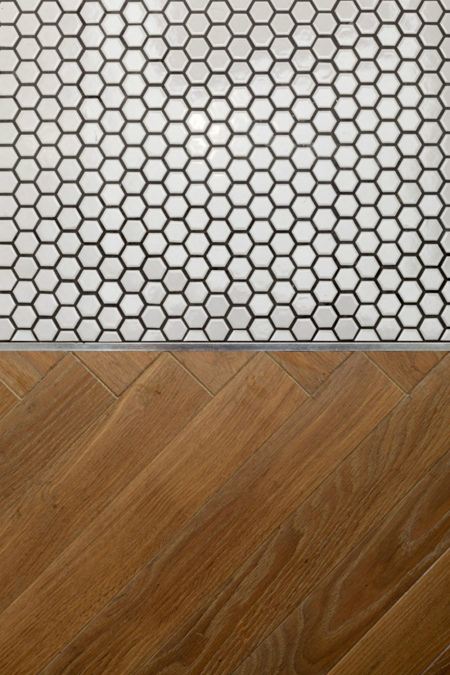 Wooden floor breaks into tiny honeycomb tiles