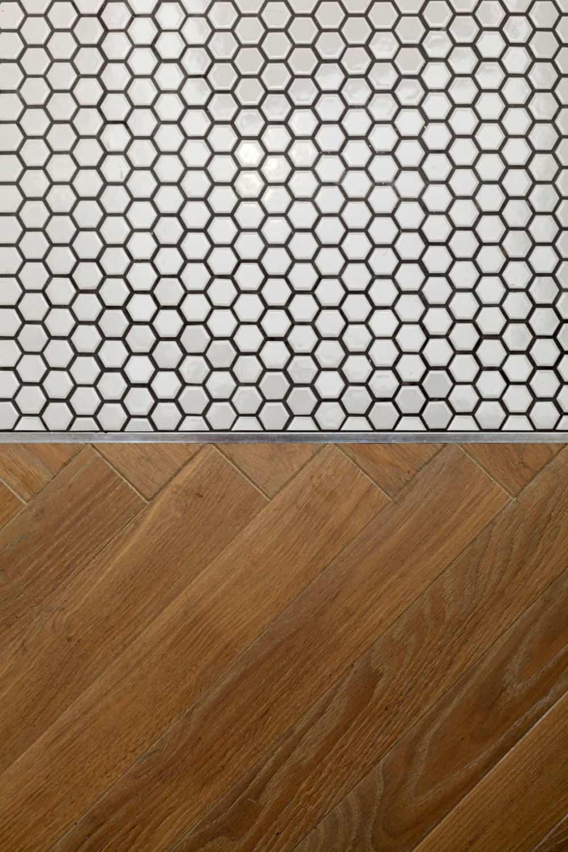 Wooden floor breaks into tiny honeycomb tiles