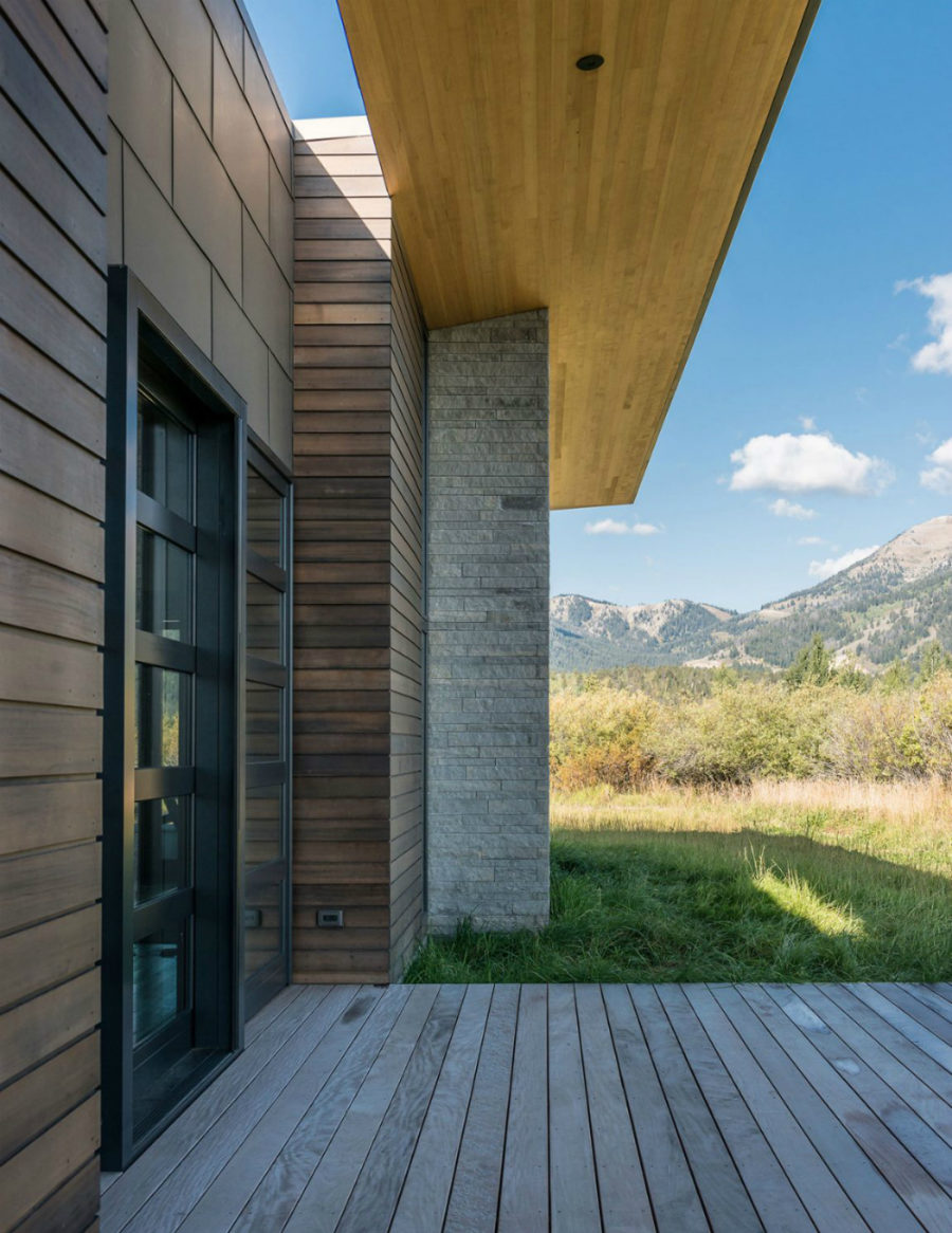 Wooden planks create a deck around the property
