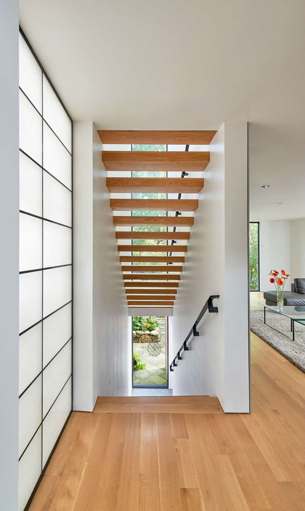 Wooden staircase is airy and open