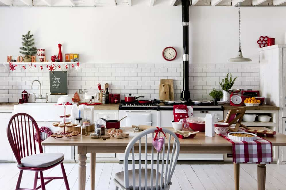 diy red accents and garlands in shared kitchen and dining room