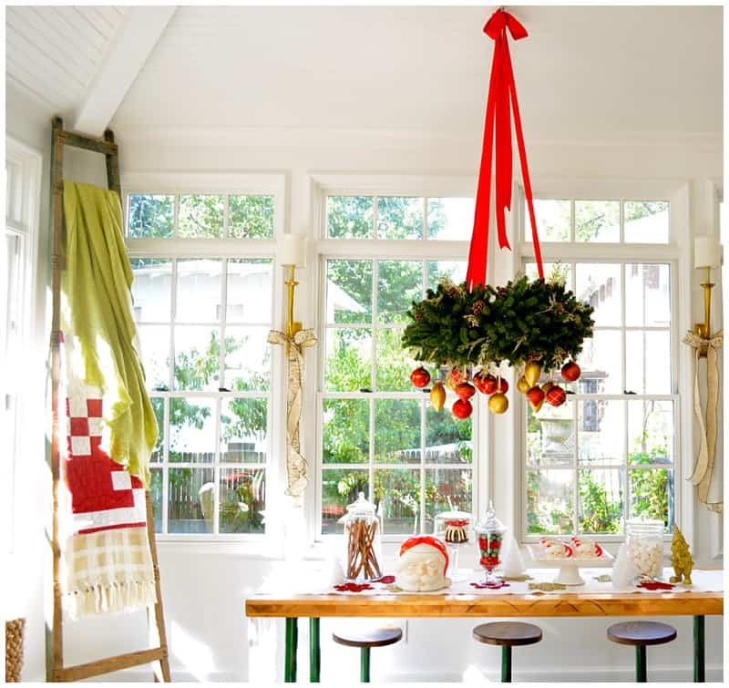 Fresh Garland Around Light Fixture In Dining Room