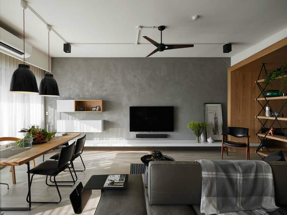 A minimal console lends the concrete feature wall some elegance