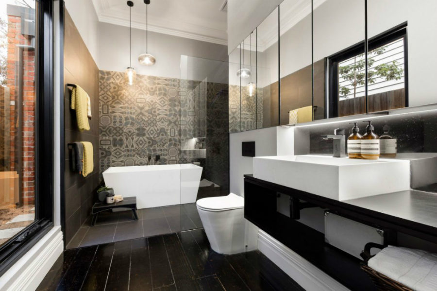 A more dramatic bath with a tiled feature wall