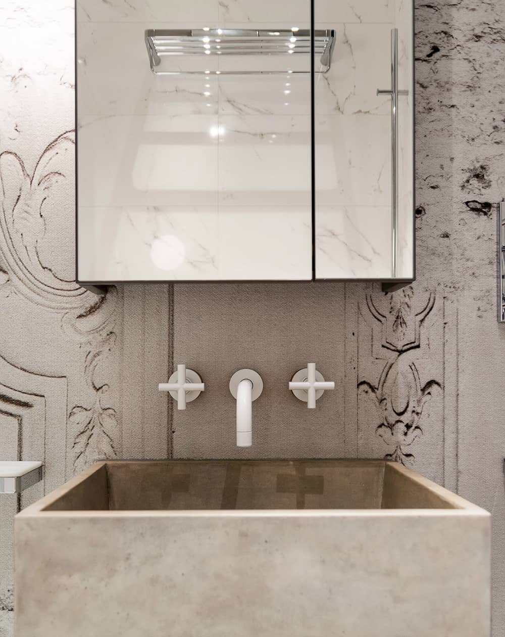 A square stone sink is as contemporary as it gets