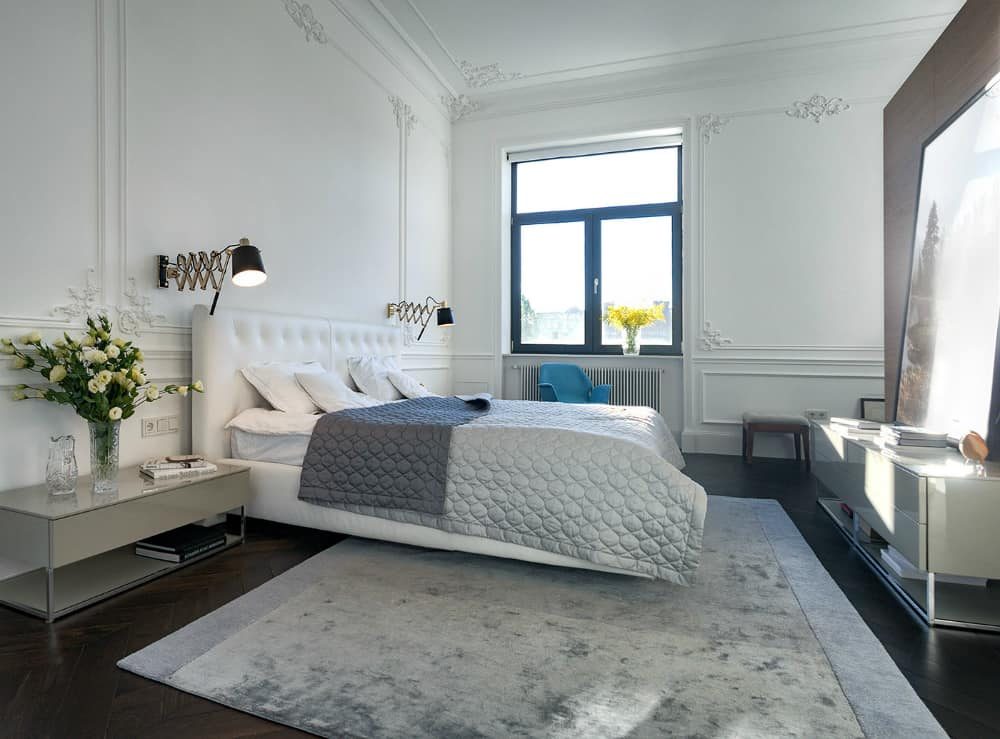 An oversized artwork adds to the elegant bedroom
