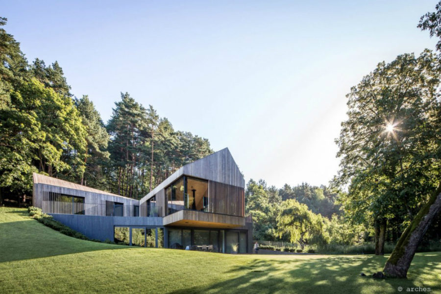 Angular architecture fits into the side of a hill 900x600 Contemporary Forest Valley Villa in Vilnius
