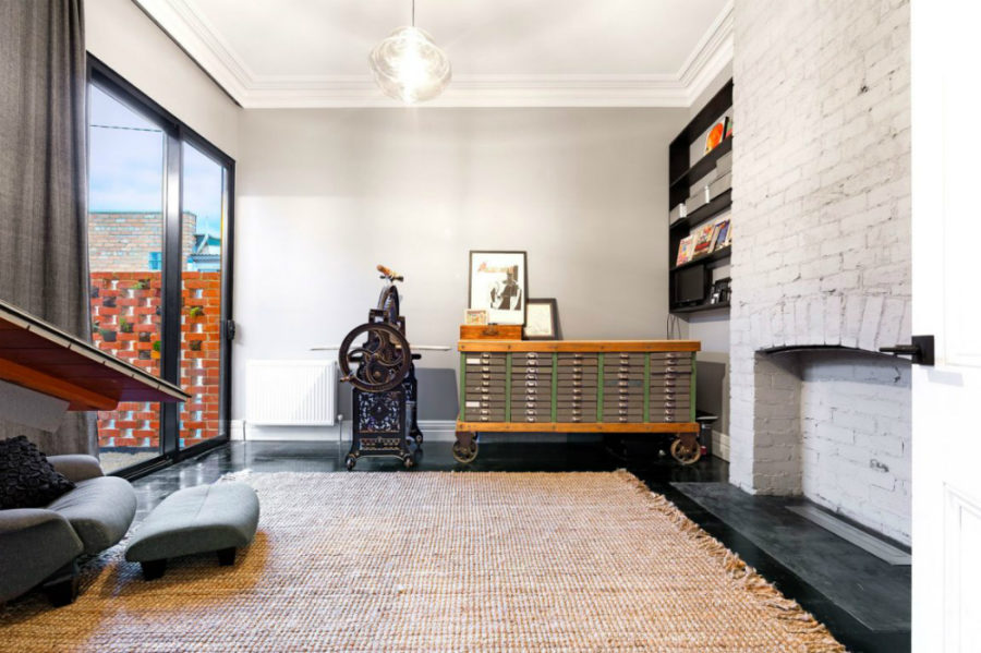 Another room features an unfunctioning fireplace
