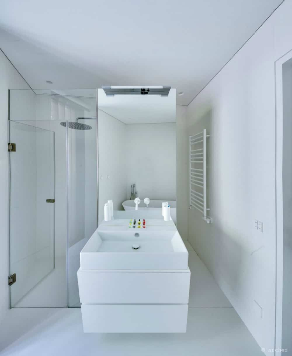 Bathroom vanity separates the shower from the tub