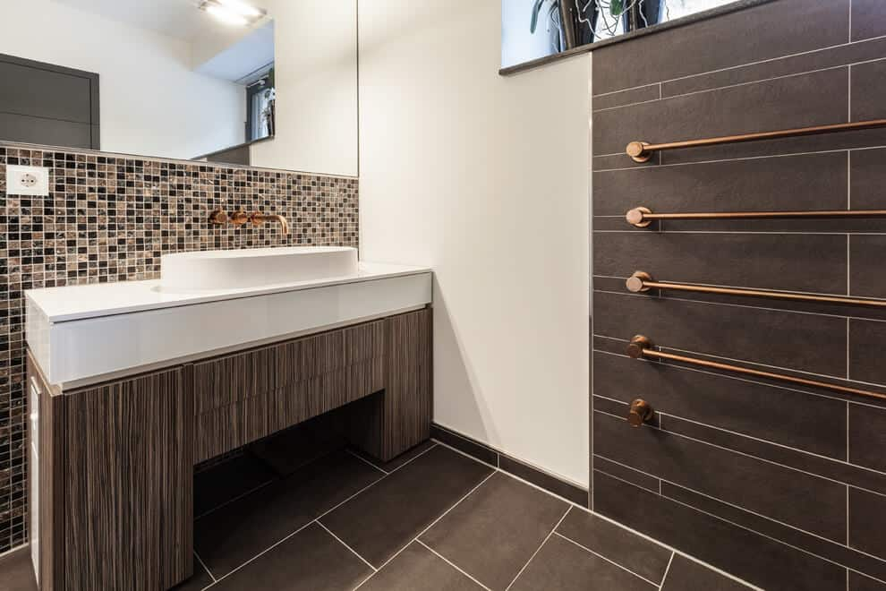 Brown bathroom design echoes the exterior elements