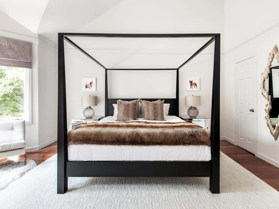 Canopy bed as a focal point in a bedroom by Claire Paquin