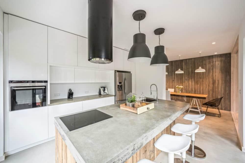 Concrete kitchen island works as a breakfast bar