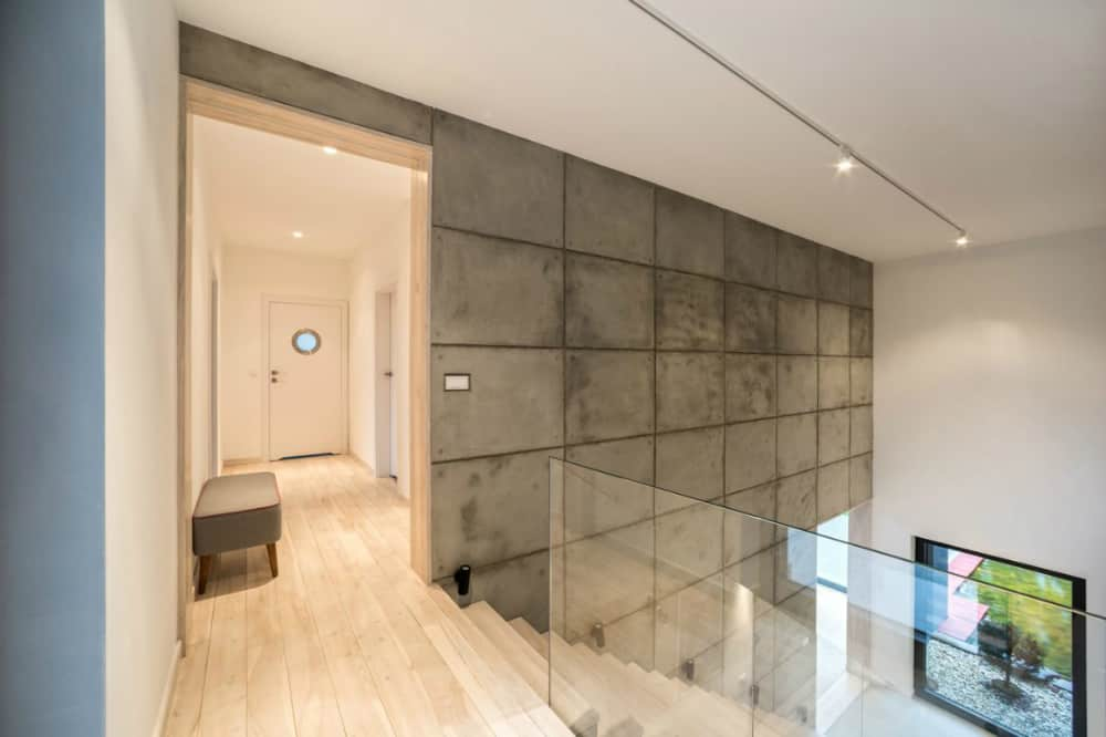 Concrete looks great in contrast with white plaster