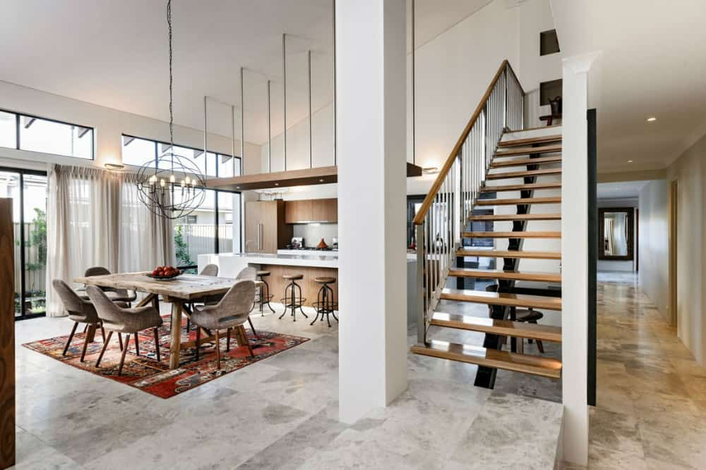 Continuing the warm wood aesthetic staircase leads to the second floor