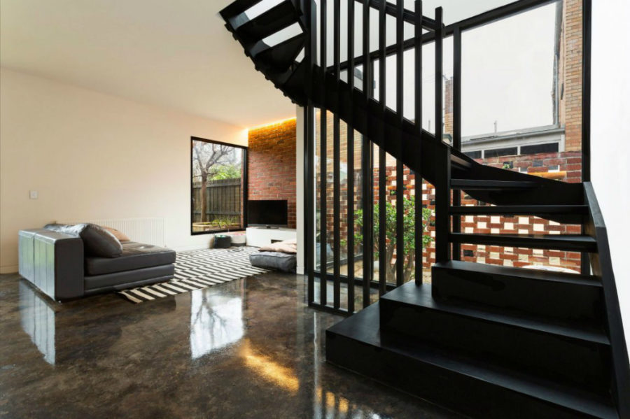 Cool living room window opens up a fenced corner
