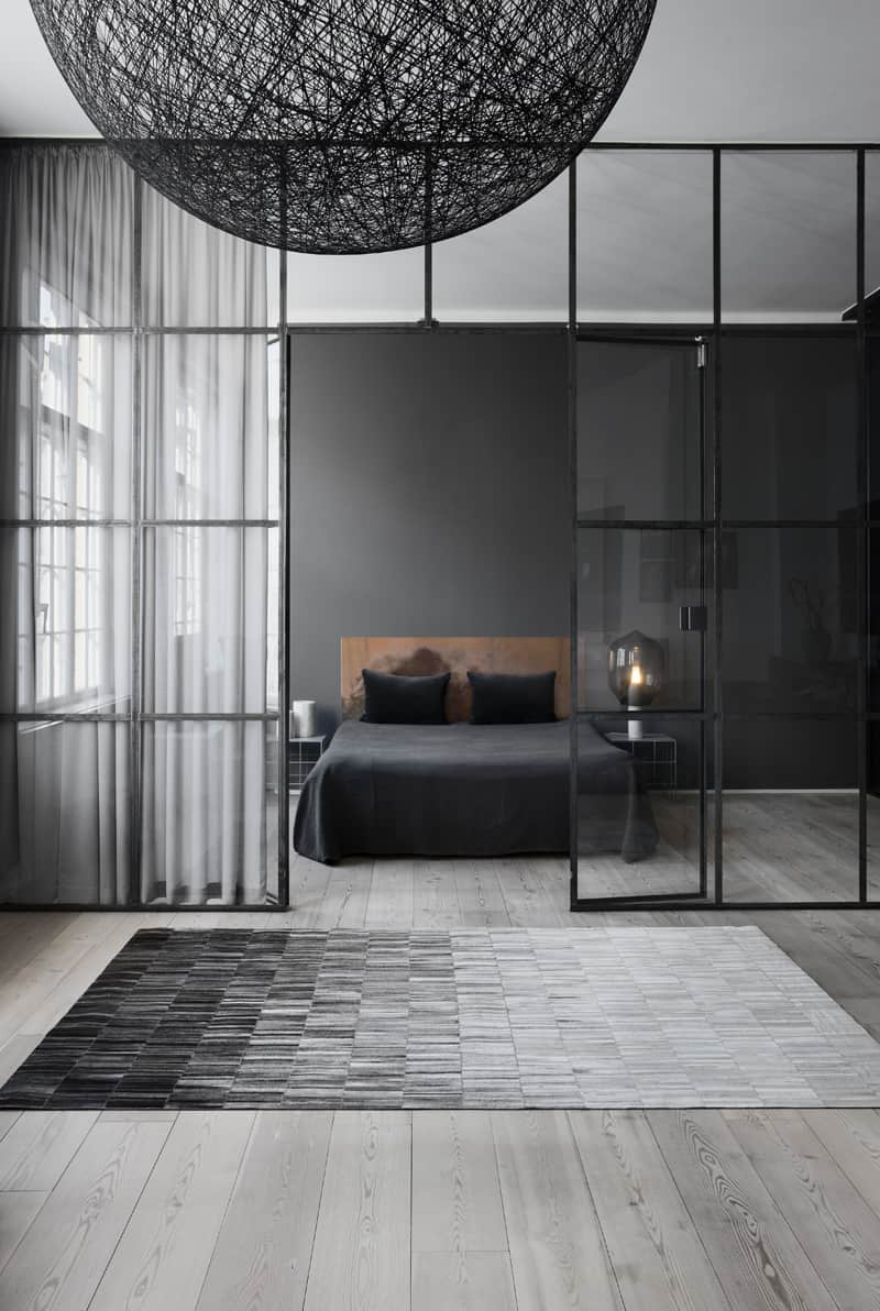 Dark grey bedroom by Linie Design