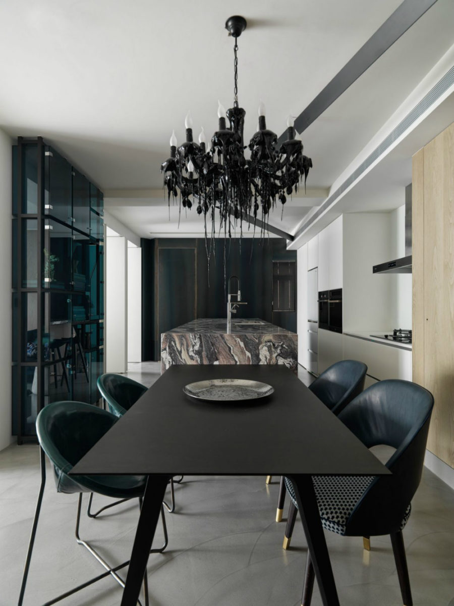 Dining room adjoined by the kitchen