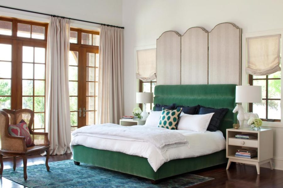 Dramatic double headboard in a bedroom by Andrea Schumacher