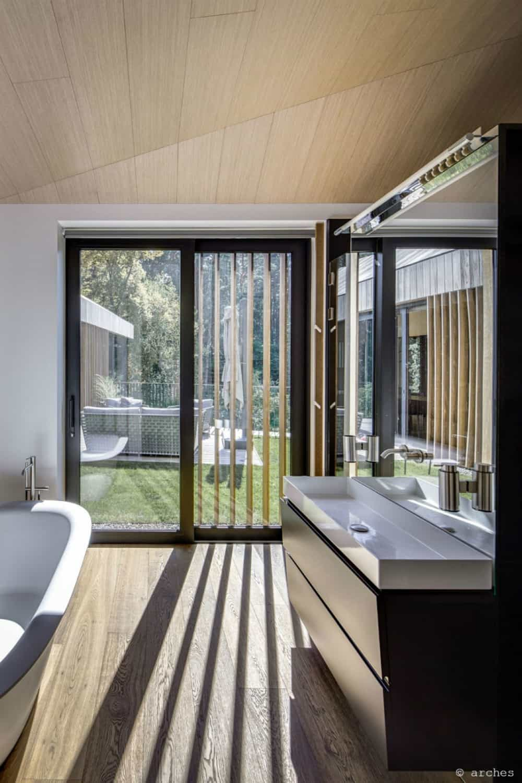 Even bathroom has its sliding glass door