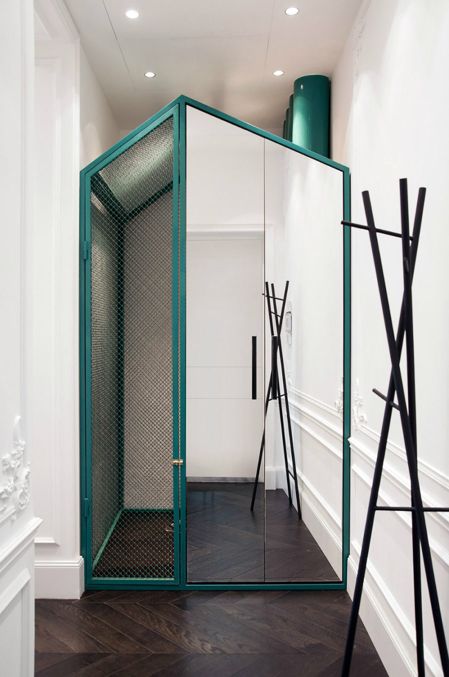 House within a home closet in the hallway amplifies space with a mirror 900x1355 19th Century Apartment Gets Contemporized in Kiev