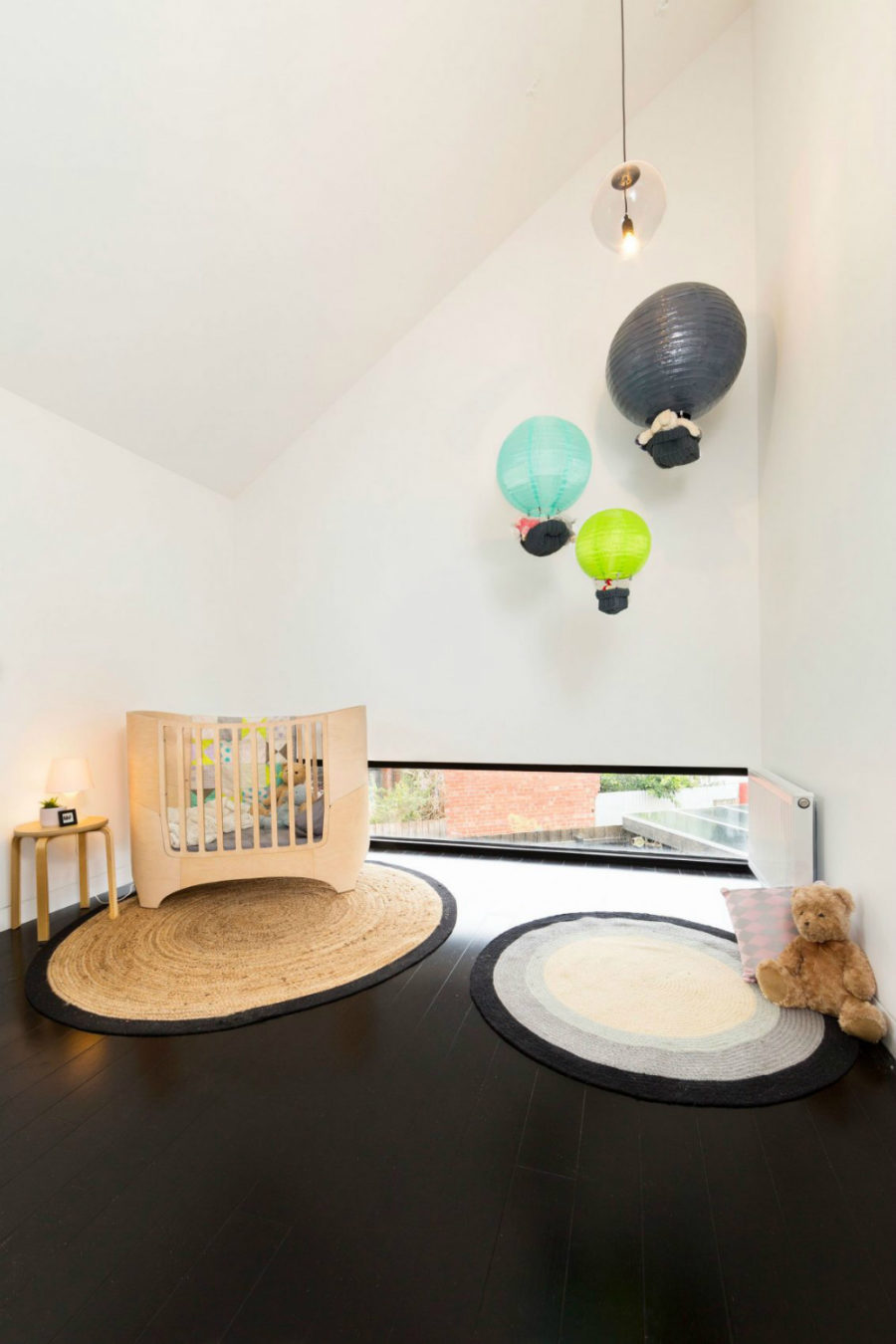Kids room overlooks the backyard through a small transom