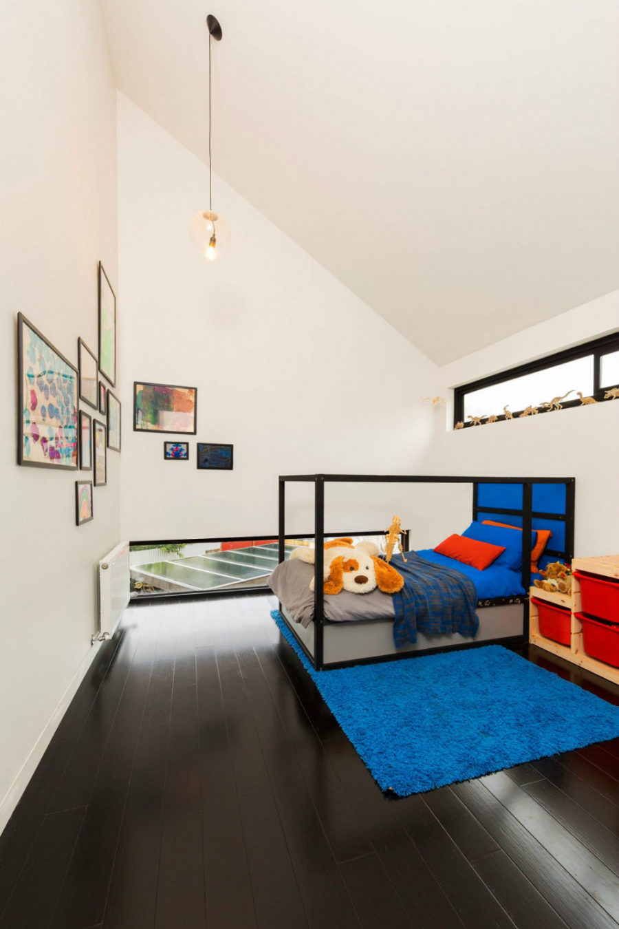 Kids room with a vaulted ceiling