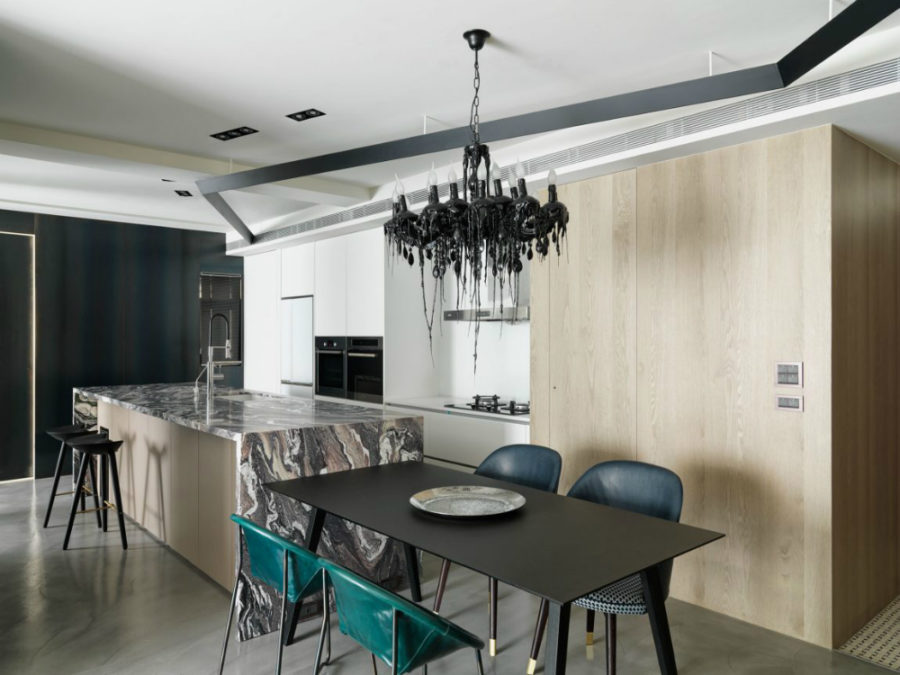 Kitchen continues organically from the living area wooden storage 900x675 This Taipei Apartment is Deliciously Dramatic