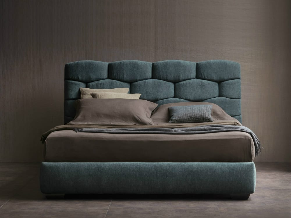 Majal bed with interesting headboard by Flou