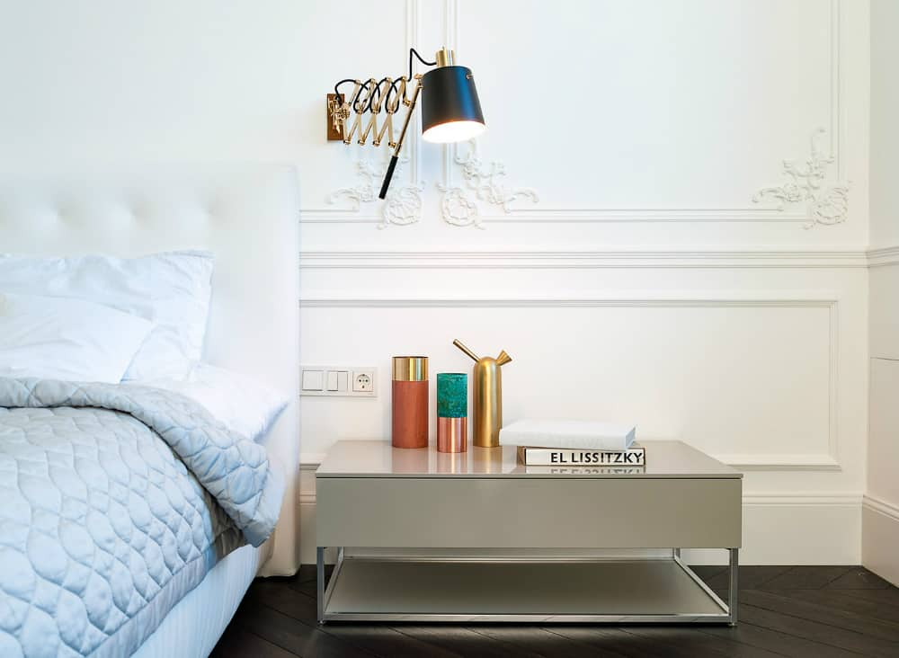 Minimal nightstands complement more elaborate night lamps