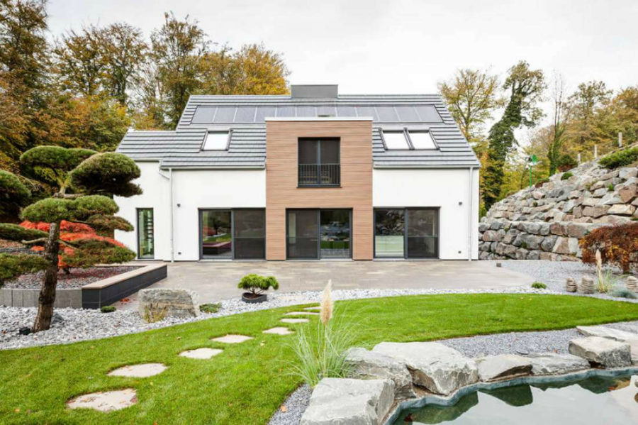 Modern structure is bigger than the original 900x599 1947 German Home Gets a Modern Facelift and Extension