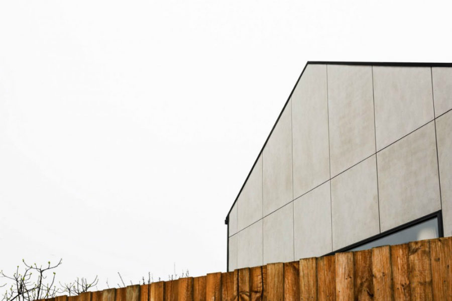 Monolithic siding lends the house its name