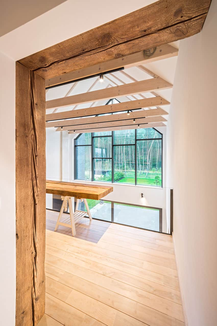 Natural wood shows through in the doorways a lot