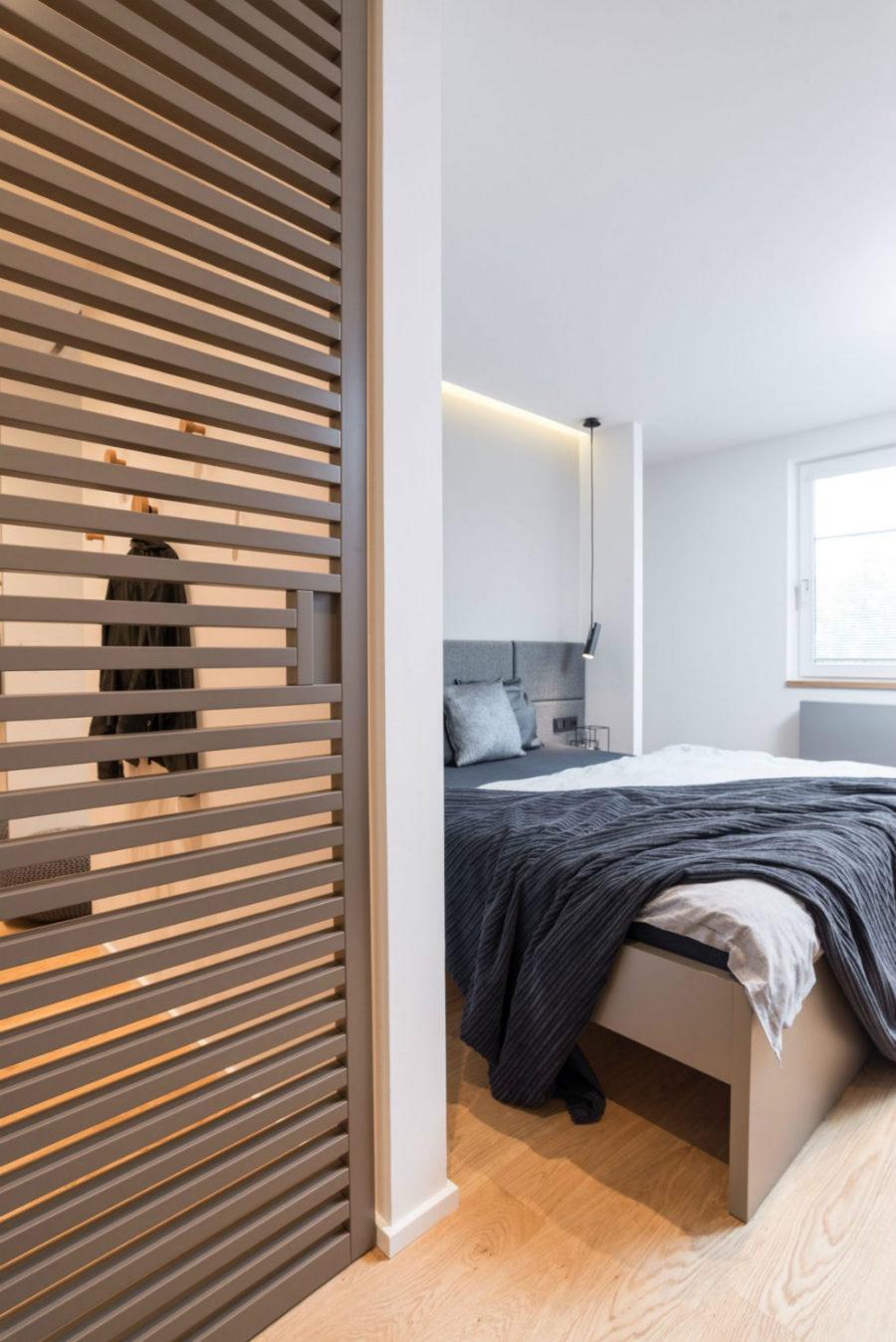 Neutral bedroom has a dressing room
