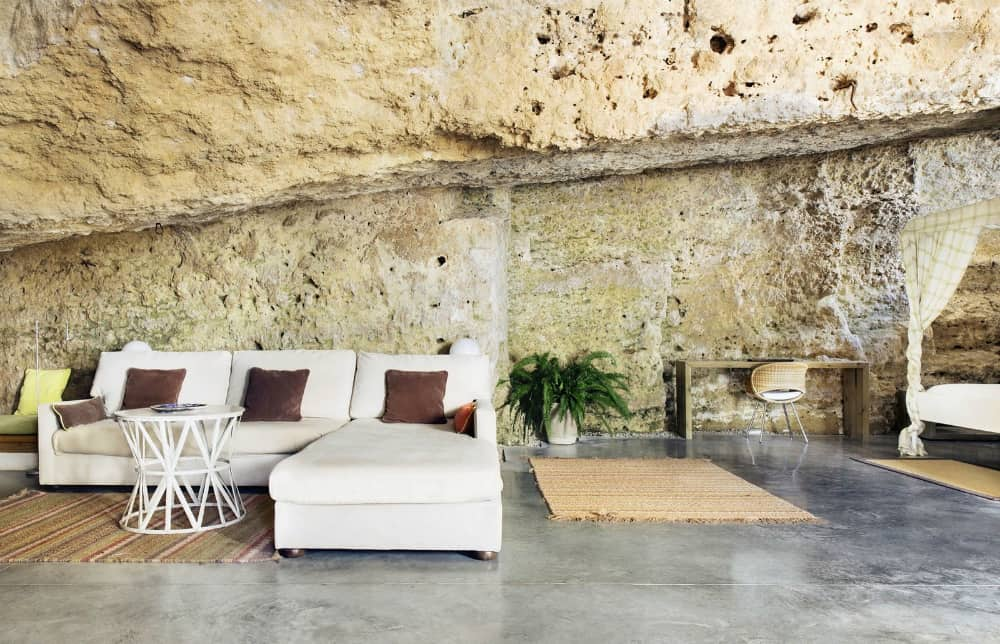 Open living area surrounded by natural stone formations