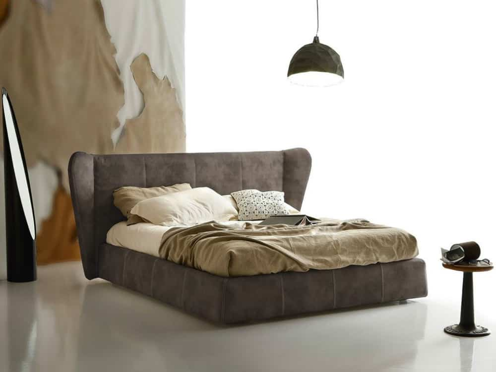 Opus bed with a winged headboard by Ditre Italia