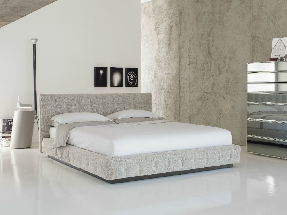 Pinch upholstered bed by Flou
