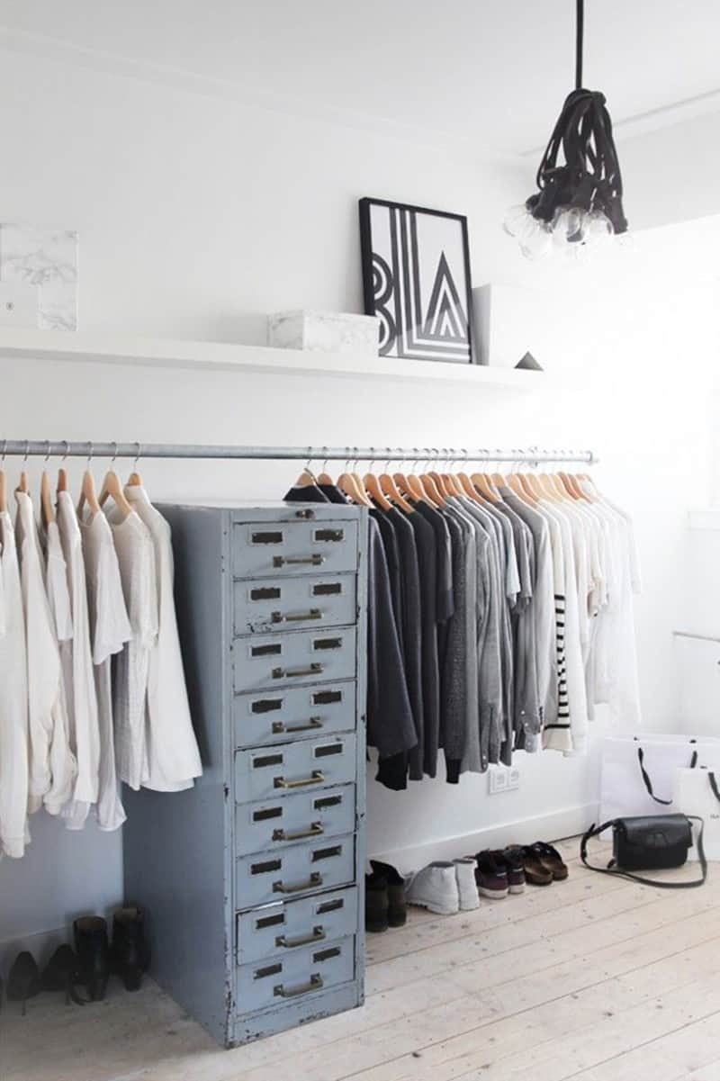 Repurposed metallic cabinet complements a continuous clothing rack