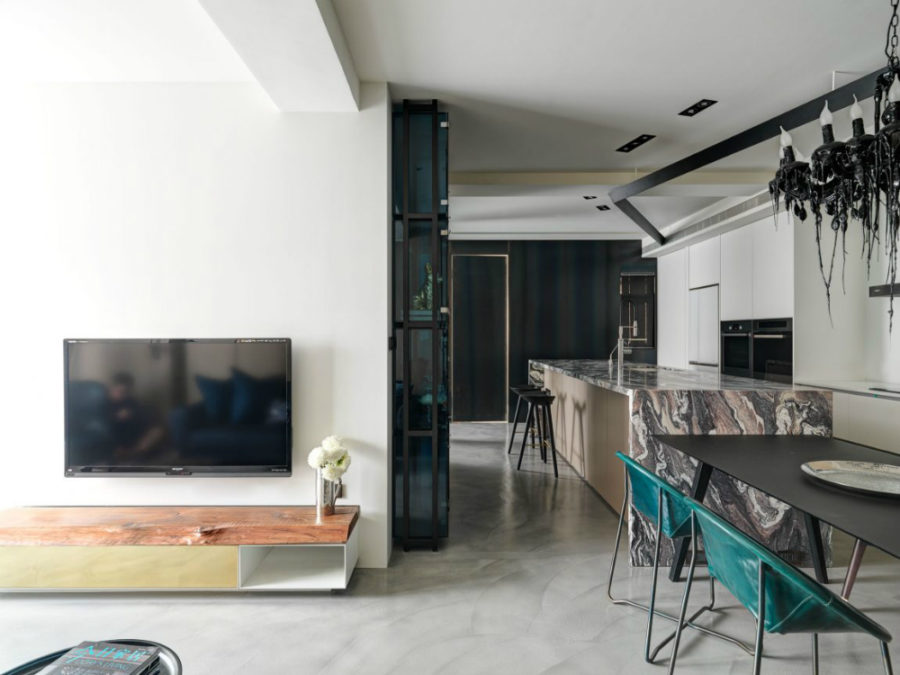 Simple TV console contrasts with ample dining room-kitchen furnishings