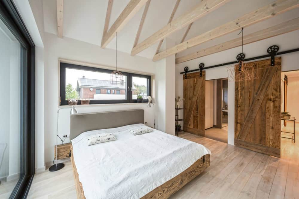 Sliding barn doors provide the bedroom with privacy