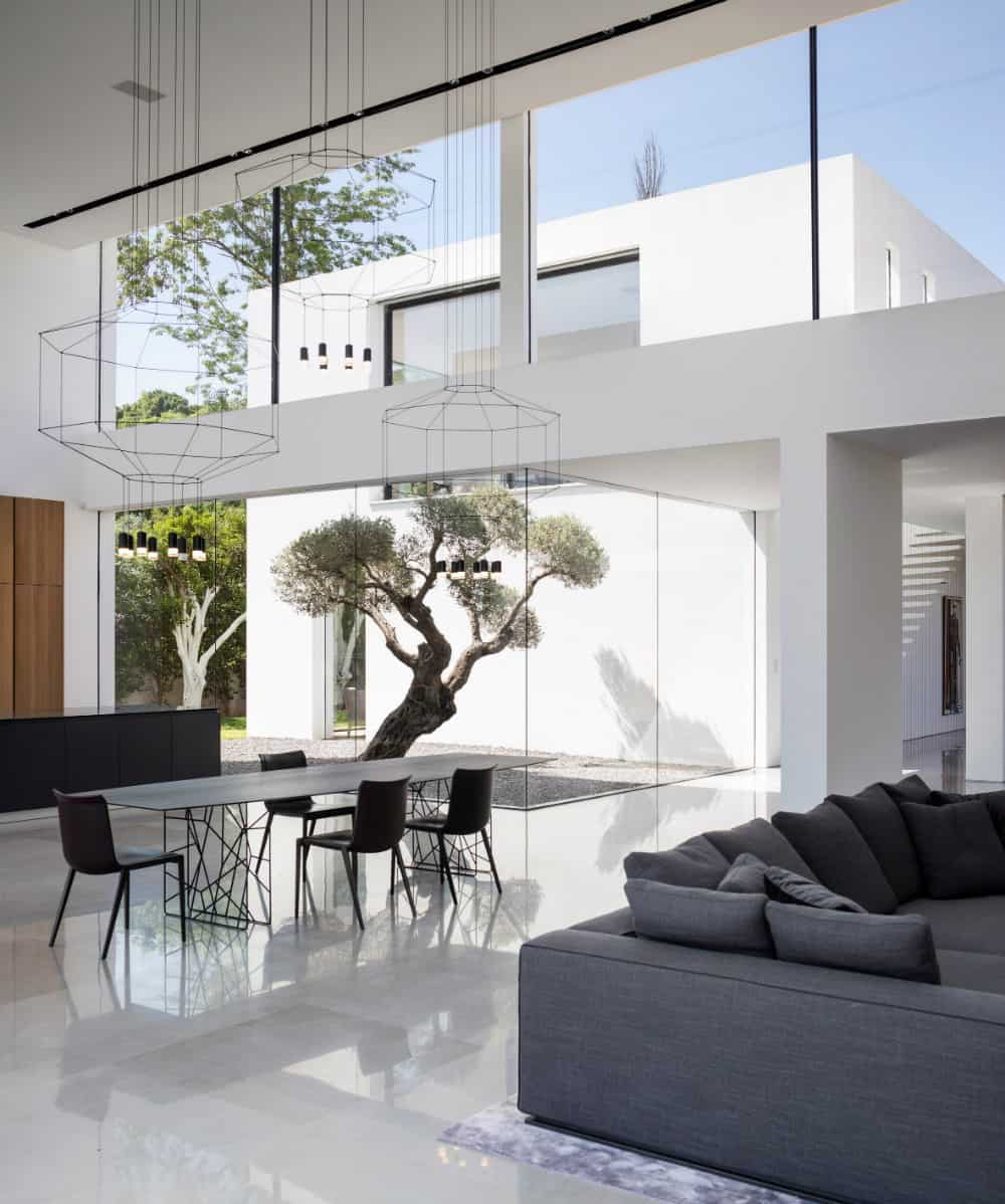 Smooth white floors enhance the pavilion atmosphere in the living room