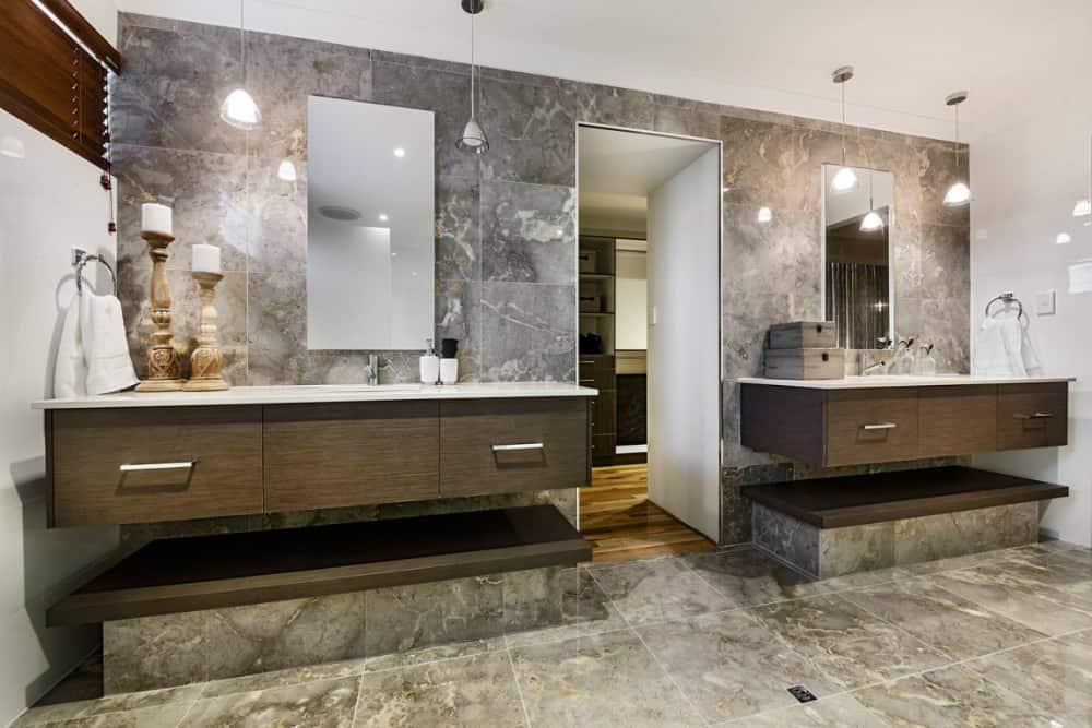 Stone-clad bathroom has grandeur to it