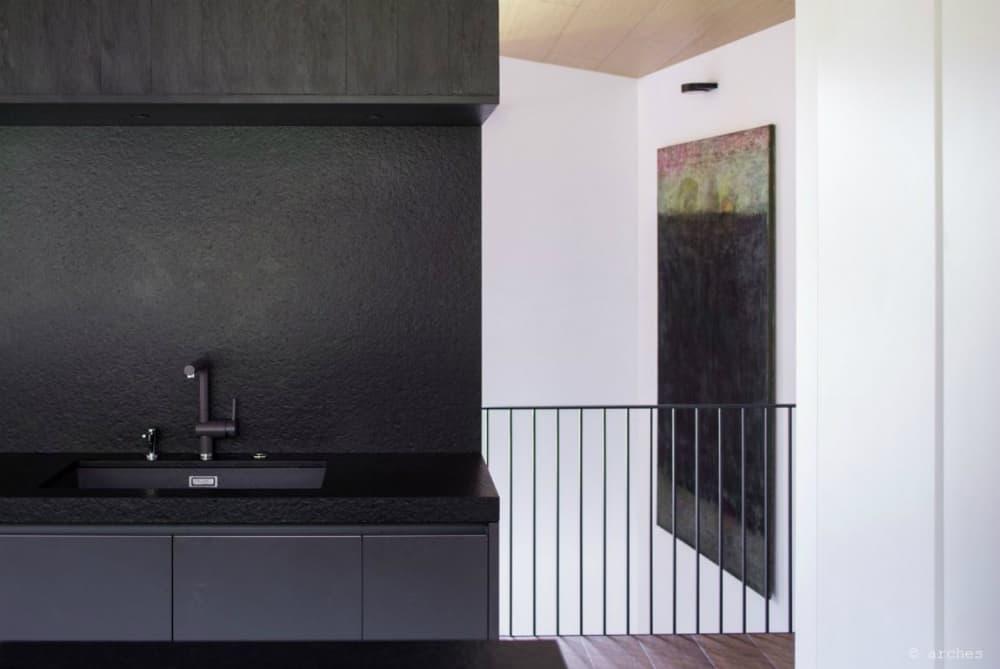 Textured countertops and backsplash look like lava stone