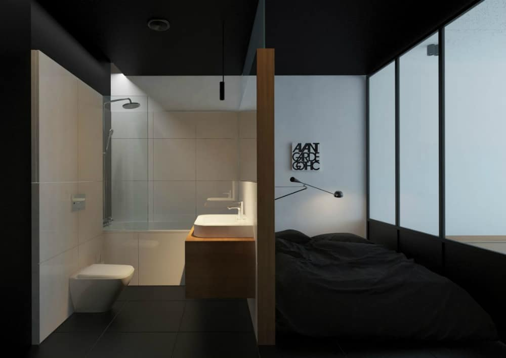 The black framed glass wall separates bedroom adn bathroom from the main area