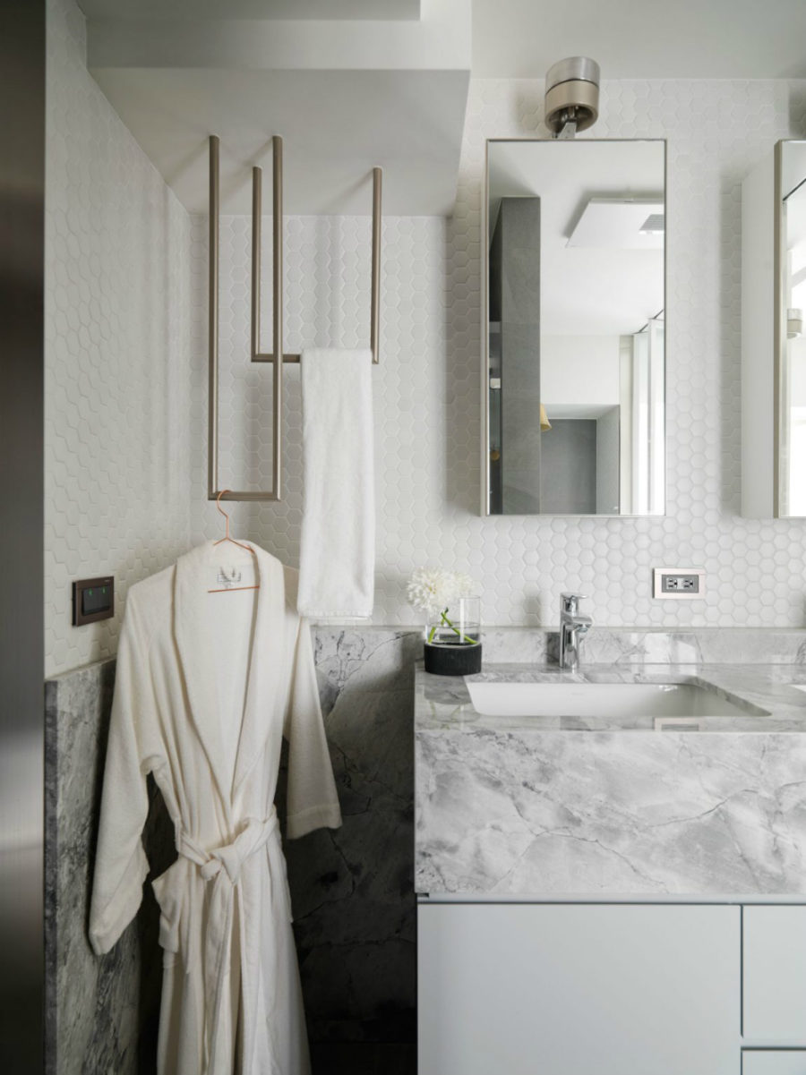 Tile continues inside the room with stone countertops and backsplash completing the look