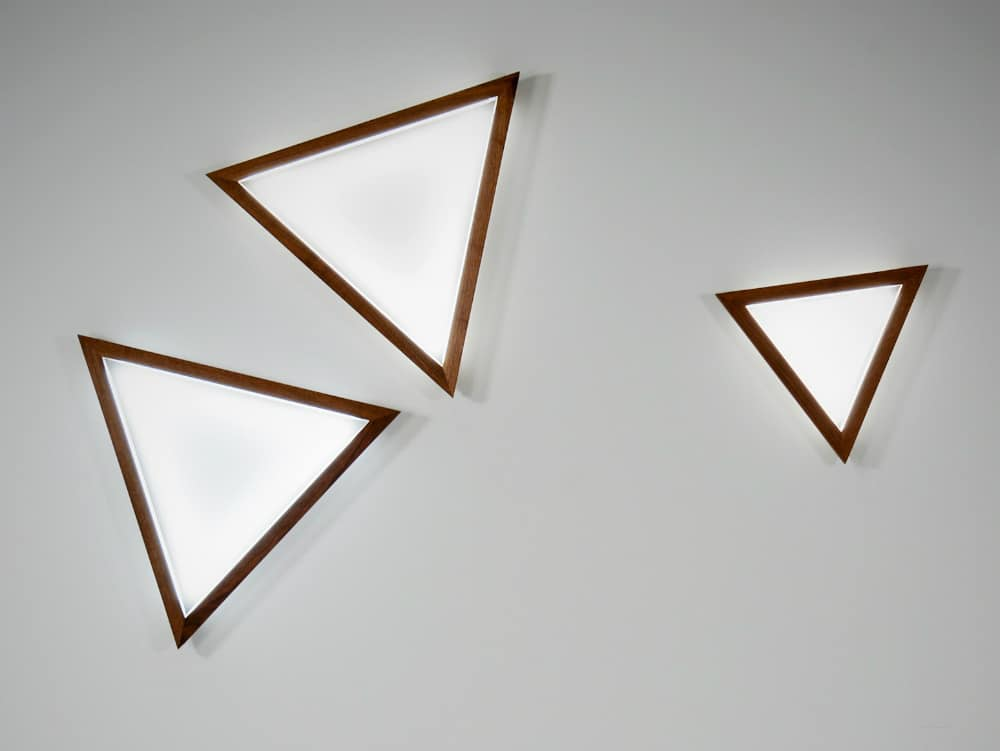 Triangle wall light by Hollis+Morris