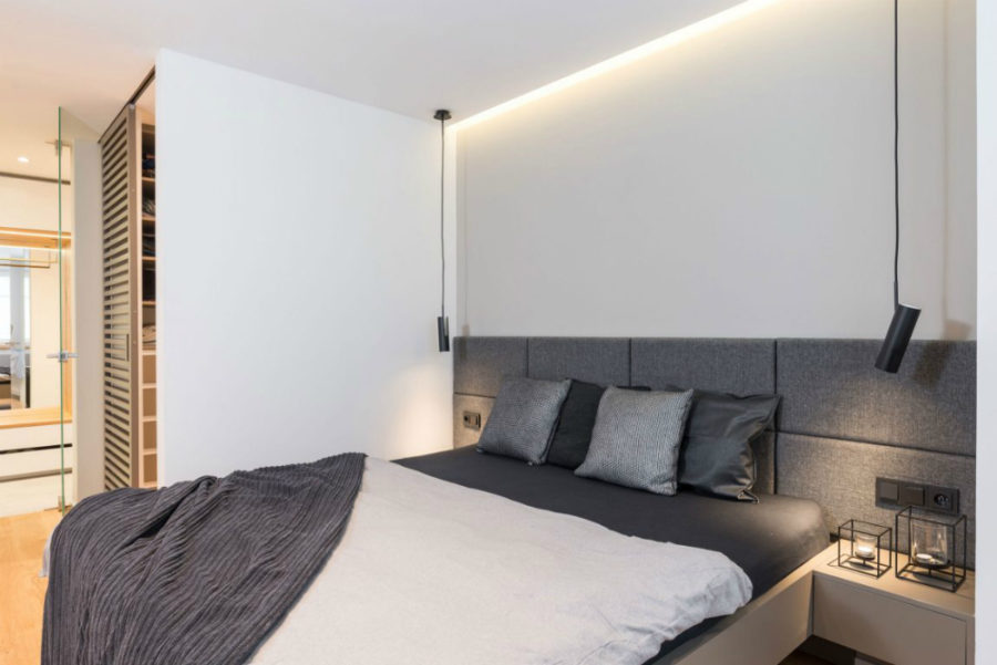 Upholstered headboard goes from wall to wall