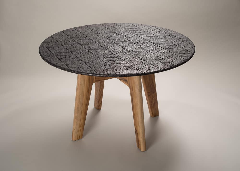 Volcanic rock into lava dining table by Peca