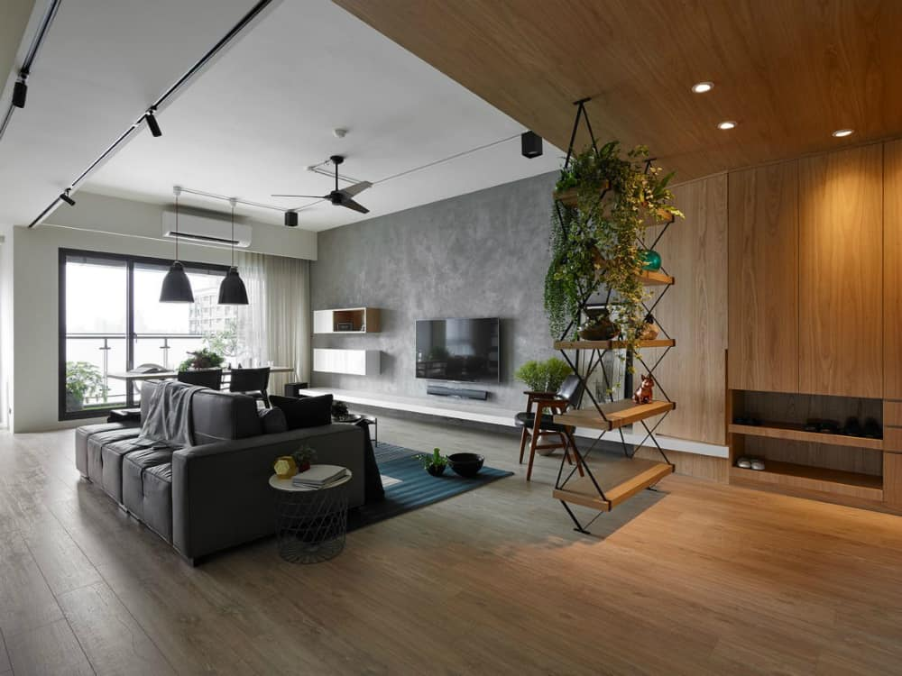 Wood and concrete visually separate the living are and rest of space
