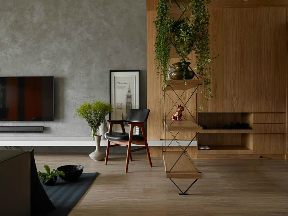 Wood and metal shelving physically divides the room into zones